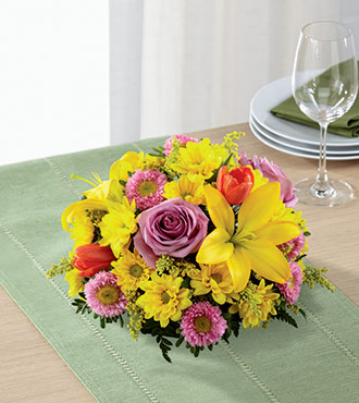 FTD® Spring Sunshine™ Centerpiece From  $66