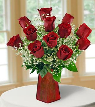 12 Red Roses with FREE Vase From  $87